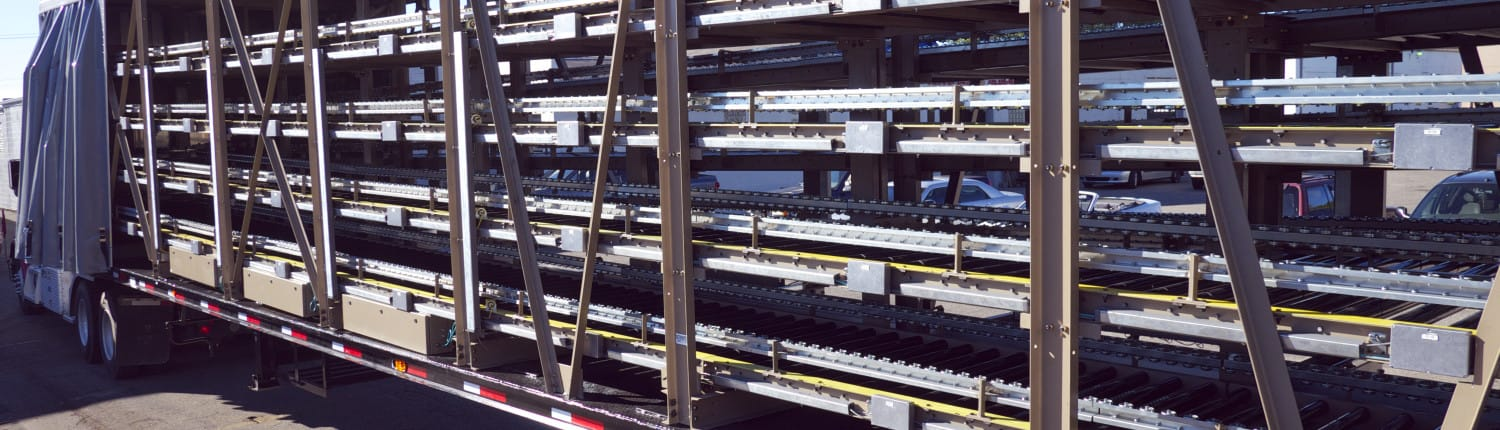 Conveyor systems for trailers